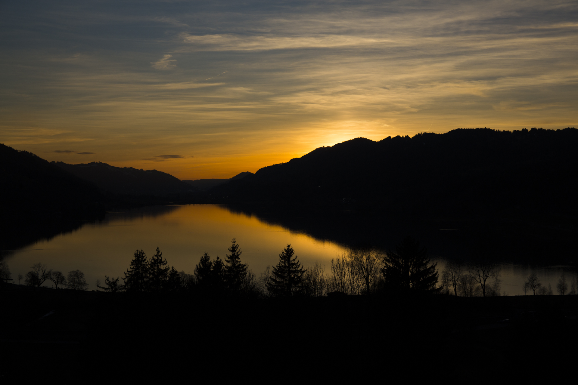 sonnenuntergang location am alpsee